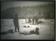 Soldiers in their foxholes outside of Bastogne